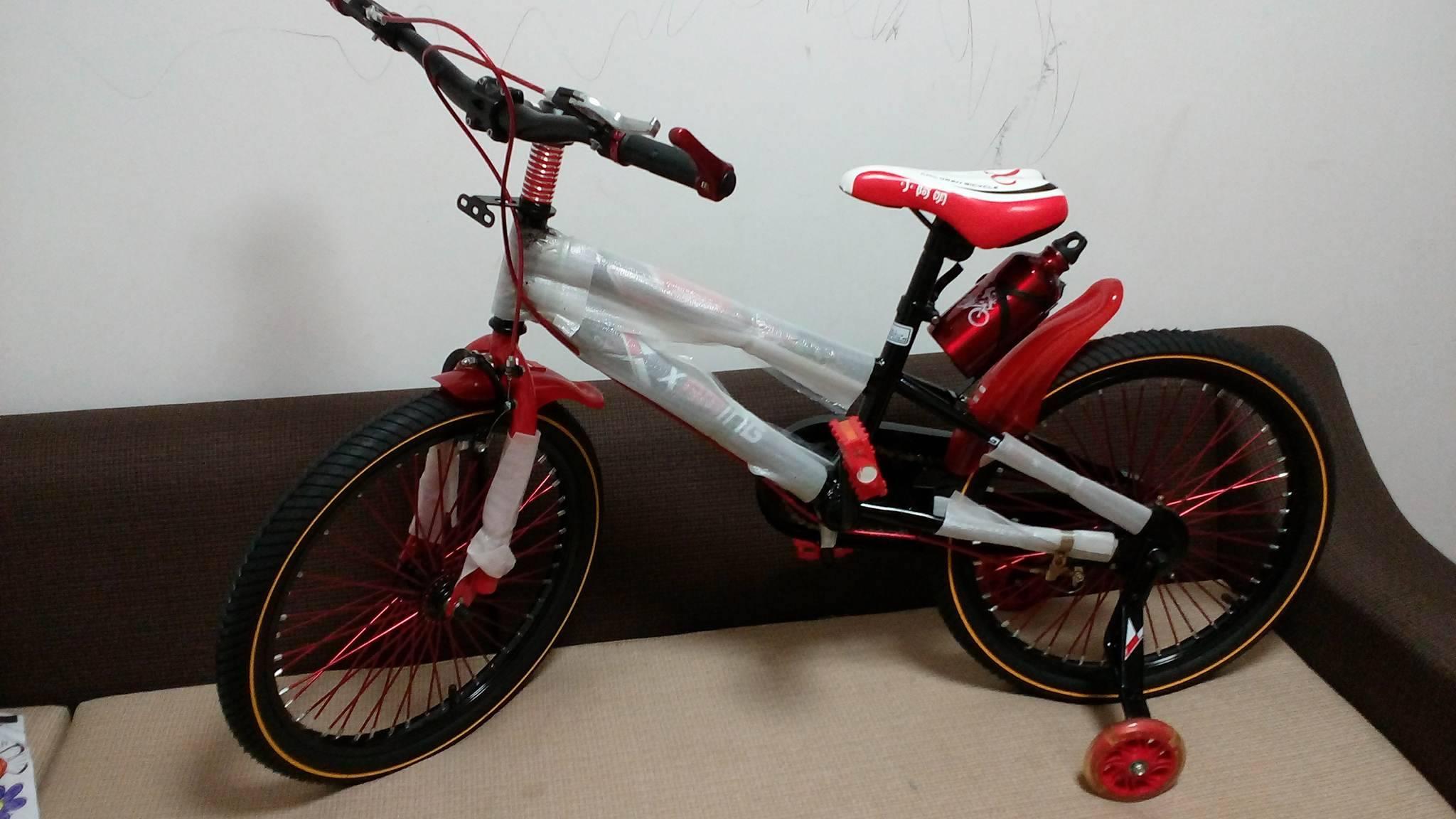 Xe đạp trẻ em cho bé 6, 7, 8, 9, 10, 11, 12 tuổi màu đỏ cỡ 20 Xiaoaming khung xe khỏe.