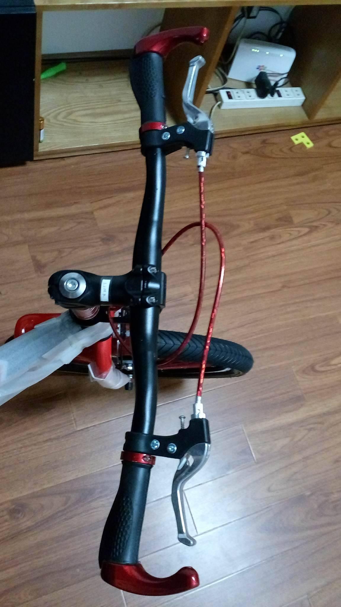 Xe đạp trẻ em cho bé 6, 7, 8, 9, 10, 11, 12 tuổi màu đỏ cỡ 20 Xiaoaming tay lái chắc chắn